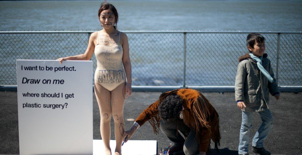Arist Ji Yeo invites strangers to draw on her body.