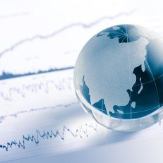 A blue and white globe sitting on a graph.