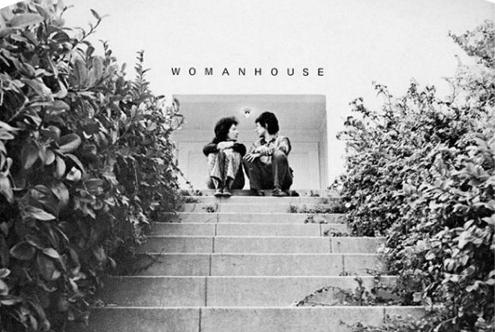 Two women face each other while sitting on steps